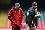 Wales coach Robert Howley and Leigh Halfpenny of Wales (r) look on during the during the Wales Rugby captains run, ahead of tomorrows RBS Six nations match against England. Principality Stadium, Cardiff, South Wales on Friday 10th Feb 2017.   pic by  Andrew Orchard, Andrew Orchard sports photography.