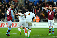 Swansea's Federico Fernandez  runs off to celebrate his goal. Barclays Premier league match, Swansea city v Aston Villa at the Liberty Stadium in Swansea, South Wales on Saturday 19th March 2016.<br /> pic by  Carl Robertson, Andrew Orchard sports photography.