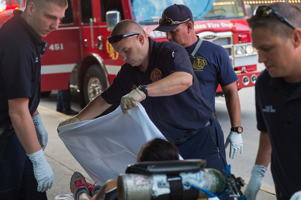 EMS Supervisor Mace and Paramedics tend to a woman believed to be overdosing on methamphetamine on a street in Charleston, WV on August 2, 2017. Paramedics have been flooded with calls related to overdoses, stretching their already limited resources.