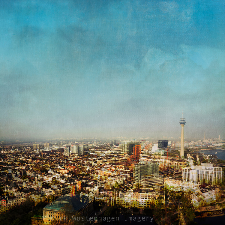 Urban landscape shot from the top of a building - double exposure edited with texture overlays