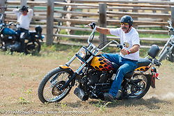 Stacy McCleary barrel racing in the Spur Creek Ranch rodeo arena on highway 79 north of Sturgis on the Michael Lichter - Sugar Bear ride during the annual Sturgis Black Hills Motorcycle Rally. SD, USA. August 3, 2014.  Photography ©2014 Michael Lichter.