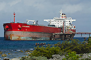 Tanker at BOPEC (Bonaire Petroleum Corporation N.V.) transshipment and storage terminal. A deep-water port, with facilities for transferring oil from ocean-going to coastal tankers. <br /> BONAIRE, Netherlands Antilles, Caribbean
