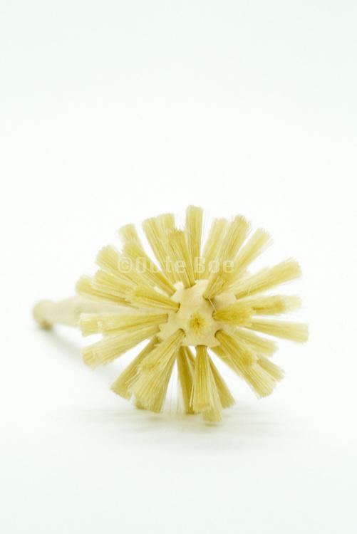 wooden dish brush with yellow bristles