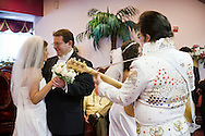 5th June 2010. Las Vegas, Nevada. Known around the world as one of the most Famous places to be married, The Little White Wedding Chapel in Las Vegas has wed stars from Britney Spears to Judy Garland. Pictured is Janet and Kent Wellish (glasses), both 40 from Vegas and Janet's brother Steve Edberg, 45, and his wife Amy, 47, from Breckenridge, Colorado. PHOTO © JOHN CHAPPLE / www.chapple.biz.john@chapple.biz  (001) 310 570 9100.