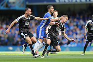 Eden Hazard of Chelsea is squeezed out by Andy King of Leicester City and Daniel Drinkwater of Leicester City.Barclays Premier league match, Chelsea v Leicester city at Stamford Bridge in London on Sunday 15th May 2016.<br /> pic by John Patrick Fletcher, Andrew Orchard sports photography.