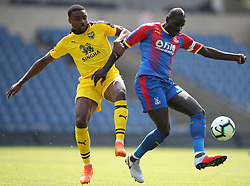 Oxford United's Jon Obika (left) and Crystal Palace's Mamadou Sakho battle for the ball during a pre season friendly match at The Kassam Stadium, Oxford.
