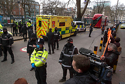 "© Licensed to London News Pictures.22/02/2021. London, UK. An ambulance arrives to An Anti-HS2 campaigner known as ""Larch"" which will be removed from London's Euston Square Gardens by bailiffs from a 100ft tunnel. Photo credit: Marcin Nowak/LNP"