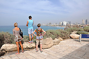 Israel, Tel Aviv tourists admire the view towards Tel Aviv from Jaffa