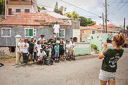 Volunteers gather for a group photo after the cleanup.  Residents and volunteers gather for the Garden Street neighborhood cleanup and block Party hosted by E's Garden and Things, Long Path/Garden Street Community Association, and the Economic Development Authority's Enterprise and Commerical Zone Commission.  St. Thomas, USVI.  5 September 2015.  © Aisha-Zakiya Boyd