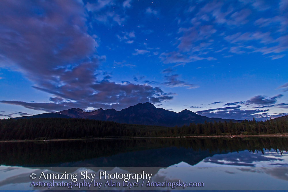 Stars of the Big Dipper in northern summer twilight and as clouds clear, over Pyramid Mountain and Patricia Lake, Jasper National Park, Alberta, Canada. Taken July 28, 2012 with the Canon 7D and 10-22mm lens for 40s at f/5.6 and ISO 800.