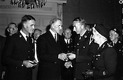 12/09/1961<br /> 09/12/1961<br /> 12 September 1961<br /> Dr Joseph Barnes (left) and Dr John Murphy presented with Red Cross medal for their service in the Congo, by President Eamonn de Valera at Aras an Uachtarain. The Irish red cross committee are present with Mrs Leslie Barry, Chairman Irish Red Cross Society to the right of Dr Murphy.