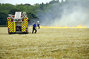 firefighters tackle a stubble fire in fields near the village of Barton Seagrave, Northamptonshire.<br />