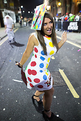 © Licensed to London News Pictures . 27/12/2016 . Wigan , UK . A woman wearing a Twister themed outfit . Revellers in Wigan enjoy Boxing Day drinks and clubbing in Wigan Wallgate . In recent years a tradition has been established in which people go out wearing fancy-dress costumes on Boxing Day night . Photo credit : Joel Goodman/LNP