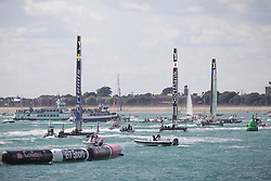 © Licensed to London News Pictures. 25/07/2015. Portsmouth, UK. The first leg of the America's Cup World Series in Portsmouth this weekend. Today, 25th July 2015, is the first race day in which British Olympic sailing legend, Sir Ben Ainslie, will be leading his all-British team, Land Rover BAR, against other teams in a battle to qualify for a place in the two team America's Cup final, to be held in Bermuda in 2017.  Photo credit : Rob Arnold/LNP
