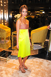 JESSICA ALBA at a Cocktail party to celebrate the opening of the new Miu Miu boutique, 150 New Bond Street, London hosted by Miuccia Prada and Patrizio Bertelli on 3rd December 2010.