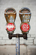 SHOT 9/10/13 8:37:06 AM - A pair of rusting, old school parking meters in downtown Buffalo, N.Y. Buffalo, N.Y. is the second most populous city in the state of New York and is located in Western New York on the eastern shores of Lake Erie and at the head of the Niagara River. By 1900, Buffalo was the 8th largest city in the country, and went on to become a major railroad hub, the largest grain-milling center in the country and the home of the largest steel-making operation in the world. The latter part of the 20th Century saw a reversal of fortunes: by the year 1990 the city had fallen back below its 1900 population levels. (Photo by Marc Piscotty / © 2013)