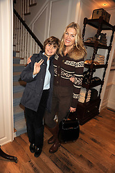 PRISCILLA PHILLIPS and her son JACK WATERS at the launch of 'A Better World' a single by Laura Comfort held at the Ralph Lauren children's store, Old Brompton Road, London on 2nd December 2008.