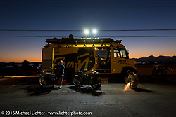 Work is being done on the German Harley-Davidsons of Paul Jung, Eric Trapp and Thomas Trapp by the W&W Motorcycles support truck at the end of the day with the sun setting over beautiful Lake Havasu during the Motorcycle Cannonball Race of the Century. Stage-13 ride from Williams, AZ to Lake Havasu City, AZ. USA. Friday September 23, 2016. Photography ©2016 Michael Lichter.