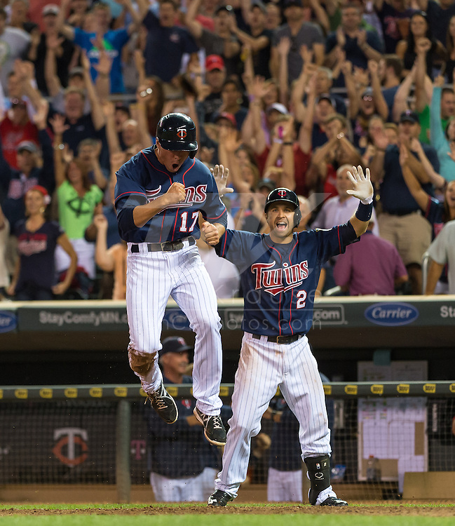 Doug Bernier #17 and Brian Dozier #2 of the Minnesota Twins celebrate after Bernier scored the winning run in the bottom of the 9th inning against the Chicago White Sox on August 15, 2013 at Target Field in Minneapolis, Minnesota.  The Twins defeated the White Sox 4 to 3.  Photo by Ben Krause