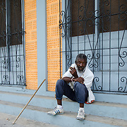 Man in street in St Johns, Antigua.
