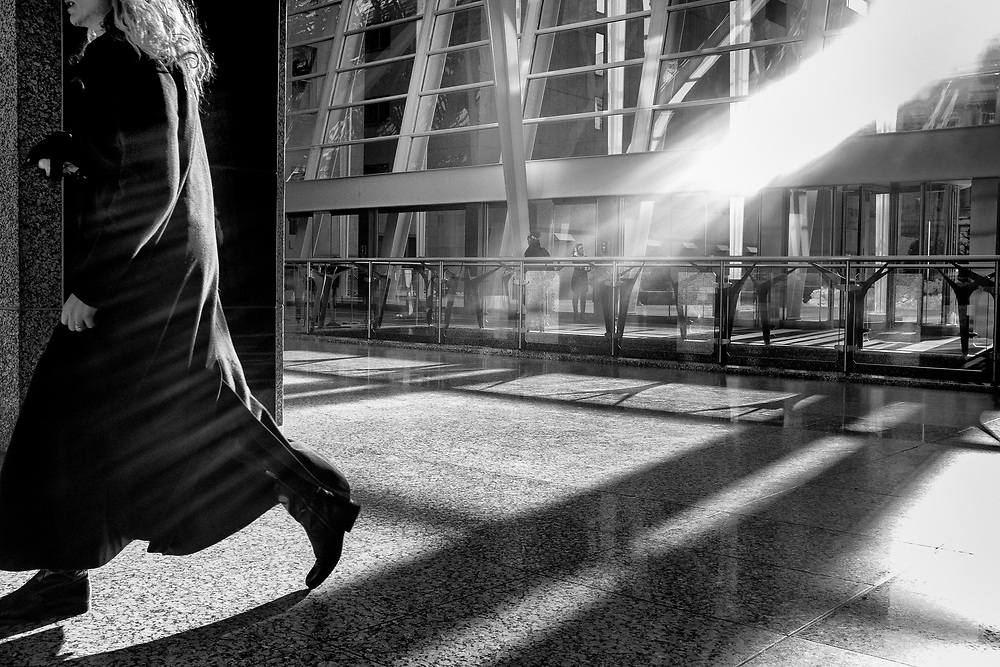 The Actuality Series documents radiant, natural light on the streets of Toronto, as it reflects and bounces off skyscrapers, manifesting in streaks of light that create interesting areas of light and dark contrast.