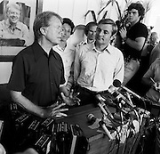President Jimmy Carter and Vice President Walter Mondale hold a press conference at the Plains, Georgia train depot that had served as the headquarters for the Carter presidential campaign in 1976. Joan Mondale stands between the President and Vice President. - To license this image, click on the shopping cart below -