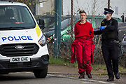 Kent Police officers arrest a Palestine Action activist after a vehicle was used to block an entrance to the Instro Precision factory in Discovery Park on 4th October 2021 in Sandwich, United Kingdom. Instro Precision is a subsidiary of Israels largest publicly-traded arms company Elbit Systems supplying high precision military equipment and Palestine Action contends that Instro Precision equipment has been used by the Israeli military against the population of Gaza.