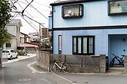 house with large doll in window Japan Yokosuka
