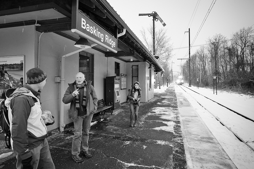 With the train approaching, commuters leave the warmth of the station and ready themselves on the platform to board.