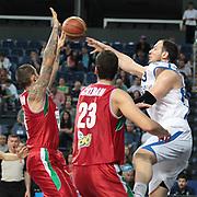Anadolu Efes's Ermal Kurtoglu (R) during their Turkish Basketball League Play Off match Anadolu Efes between Pinar Karsiyakaat Sinan Erdem Arena in Istanbul, Turkey, Sunday, May 06, 2012. Photo by TURKPIX