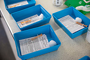 Clinical trays ready for patients arriving at the Folkestone drive through medical centre where patients receive their first dose of the COVID-19 AstraZeneca Oxford vaccine in the car park of Folkestone council offices on Saturday the 27th of February 2021, Folkestone, Kent, United Kingdom.
