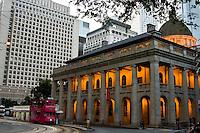 Trams run through downtown Hong Kong where modern archectecture blends among a few classic old buildings.