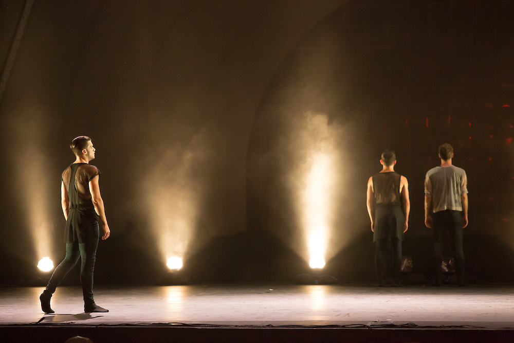"A foggy scene in ""Night Box"" by Wen Wei Wang. The set and costumes were in shades of  gray and black."