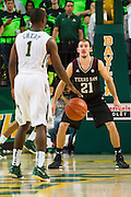 WACO, TX - DECEMBER 9: Alex Caruso #21 of the Texas A&M Aggies defends against Kenny Chery #1 of the Baylor Bears on December 9, 2014 at the Ferrell Center in Waco, Texas.  (Photo by Cooper Neill/Getty Images) *** Local Caption *** Alex Caruso