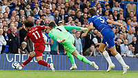 Football - 2018 / 2019 Premier League - Chelsea vs. Liverpool<br /> <br /> Mohamed Salah (Liverpool FC) leaves Marcos Alonso (Chelsea FC) on the floor and rounds Kepa Arrizabalago (Chelsea FC) before shooting from a tight angle at Stamford Bridge <br /> <br /> COLORSPORT/DANIEL BEARHAM