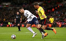 Tottenham Hotspur's Erik Lamela (left) and Watford's Jose Holebas battle for the ball