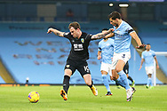 Burnley forward Ashley Barnes (10) holds off Manchester City defender Rúben Dias (3) during the Premier League match between Manchester City and Burnley at the Etihad Stadium, Manchester, England on 28 November 2020.