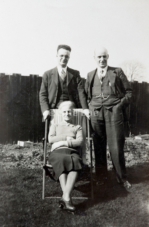 various generations in a backyard posing England 1930s