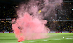 """A flare is thrown onto the pitch during the Premier League match at Vicarage Road, Watford PRESS ASSOCIATION Photo. Picture date: Saturday September 15, 2018. See PA story SOCCER Watford. Photo credit should read: Nigel French/PA Wire. RESTRICTIONS: EDITORIAL USE ONLY No use with unauthorised audio, video, data, fixture lists, club/league logos or """"live"""" services. Online in-match use limited to 120 images, no video emulation. No use in betting, games or single club/league/player publications."""