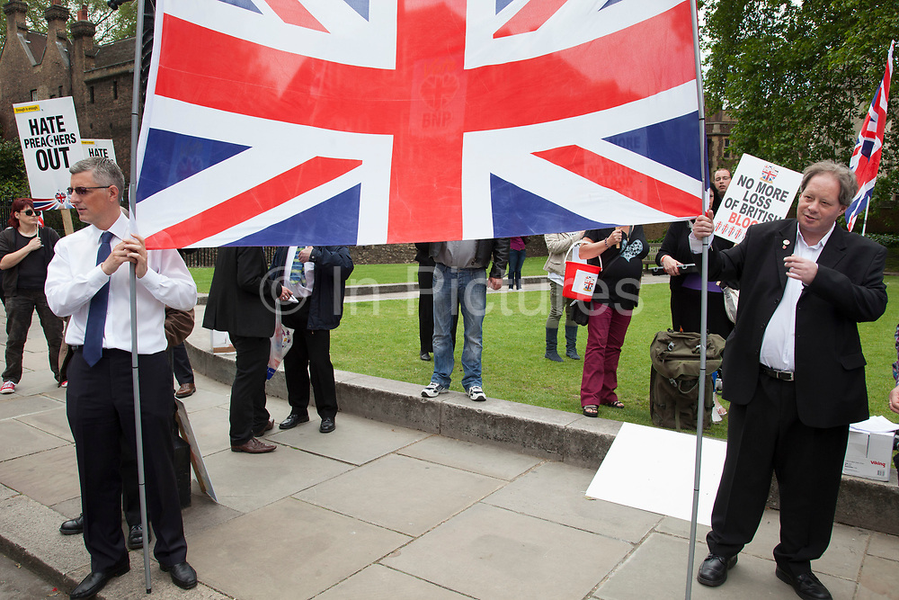 London, UK. Saturday 1st June 2013. Members of the British National Party BNP gather to protest against hate preachers. Unite Against Fascism organised this counter-demonstration in which police had to keep both sides apart.
