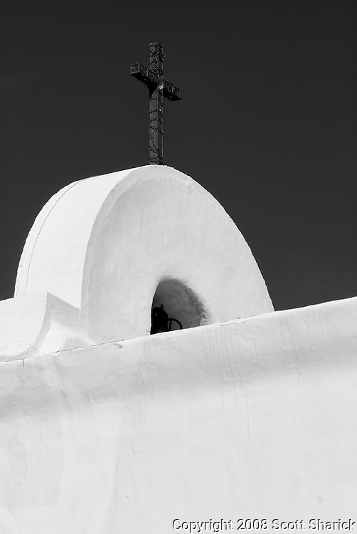 A cross on top of an adobe mission in New Mexico.