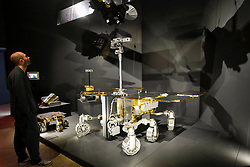 "© Licensed to London News Pictures. 17/10/2019. LONDON, UK. A staff member views the ExoMars Rosalind Franklin rover  from the European Space Agency.  Preview of ""Moving to Mars"" at the Design Museum. The exhibition explores how sending humans to Mars is a frontier for science as well as design and features over 200 exhibits from NASA, the European Space Agency together with new commissions.  The show is open 18 October to 23 February 2020.  Photo credit: Stephen Chung/LNP"