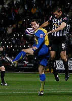 Photo: Steve Bond.<br />Notts County v Hereford United. Coca Cola League 2. 02/10/2007. Steve Guinan (L) loses out to Adam Tann (R)