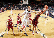 Nov 6, 2010; Charlottesville, VA, USA; Virginia Cavaliers James Johnson (34) reaches for a rebound in front of Roanoke College Joey Leech (42) Saturday afternoon in exhibition action at John Paul Jones Arena. The Virginia men's basketball team recorded an 82-50 victory over Roanoke College.