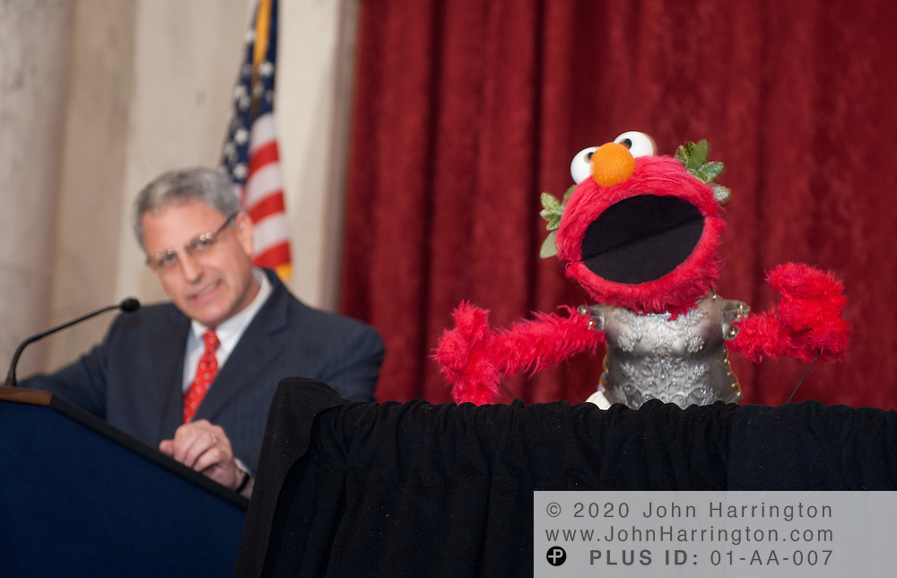 """Sesame Workshop President and CEO Gary E. Knell speaks, alongside Sesame Street character Elmo, at a press conference announcing a new partnership between The National Children's Museum and the Sesame Workshop at the Russell Senate Office Building in Washington, DC on February 3, 2011.  The Sesame Workshop, the organization behind the television show """"Sesame Street"""" will have a permanent home in the nation's capital, a move that will expand the organization's mission of education."""