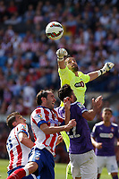 Atletico de Madrid´s Mandzukic and Godin and Espanyol´s goalkeeper Casilla during 2014-15 La Liga Atletico de Madrid V Espanyol match at Vicente Calderon stadium in Madrid, Spain. October 19, 2014. (ALTERPHOTOS/Victor Blanco)
