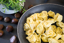 Chestnuts and Italian pasta in pan