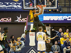 Jan 9, 2018; Morgantown, WV, USA; Baylor Bears guard Tyson Jolly (10) dunks the ball during the second half against the West Virginia Mountaineers at WVU Coliseum. Mandatory Credit: Ben Queen-USA TODAY Sports