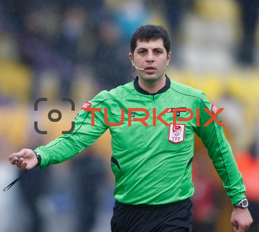 Referee's Mustafa Ogretmenoglu during their Turkey Cup matchday 3 soccer match Eyupspor between Eskisehirspor at Eyup Stadium in Istanbul Turkey on Wednesday, 11 January 2012. Photo by TURKPIX