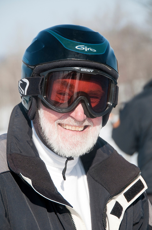 A senior citizen skier at Indianhead Mountain ski resort near Wakefield Michigan.